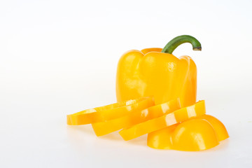 Yellow bell pepper cut in half and sliced