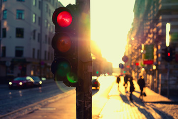 Traffic lights at night outdoors at sunset
