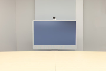 Video Conference room with one screen in front of meeting table