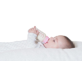 Baby boy  drinking milk from the bottle isolated