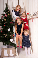 Happy kids laughing and waiting for Santa Claus