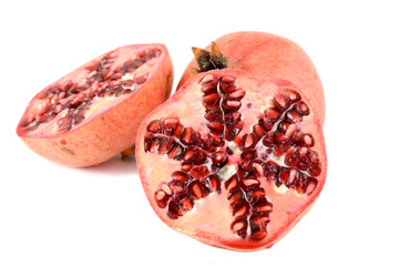 half and whole pomegranates on white background