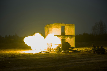shot of artillery fire with flash at night