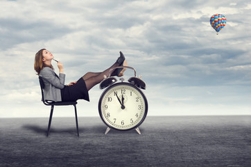 businesswoman dreaming sitting on a chair in the open air.