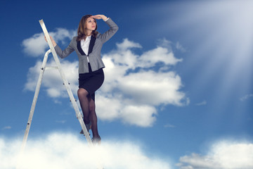 Businesswoman climbing the stairs to the sky
