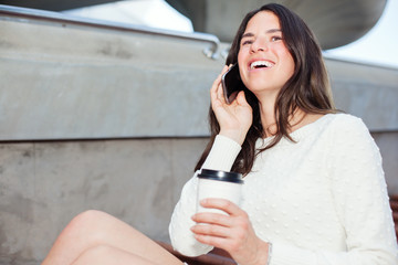 beautiful smiling woman talking on the mobile phone