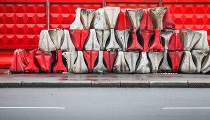 Red and white plastic road barriers