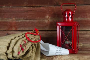 Santas equipment - burlap bag, wish list and lantern