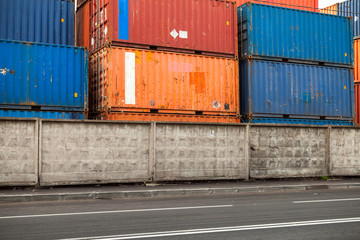 Cargo containers are stacked in the port area