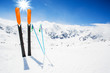 canvas print picture - Skiing , mountains and ski equipments on ski run