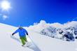 Skiing, freeski, freeride - man skiing downhill