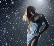 Young and sexy woman on a snowy winter background