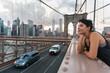 Happy Young Woman on Brooklyn Bridge