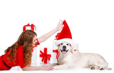 Maiden and labrador dog with Christmas gifts