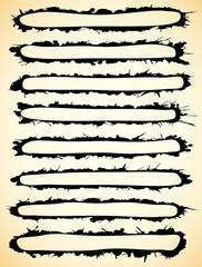 Black brush strokes made of ink splatter.