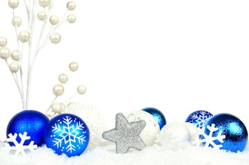 Christmas border of blue and white branches and ornaments