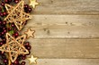 Wood Christmas background with shiny star and branch side border