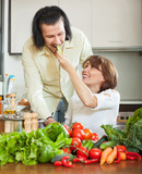 attractive man and woman with  vegetables