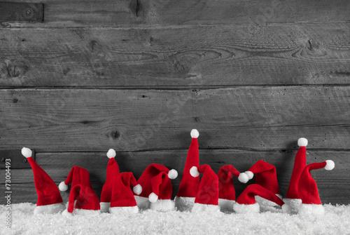 Weihnachtlicher Holz Santa Hintergrund in grau, rot und weiß