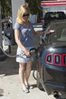 Woman motorist at a gas station in USA