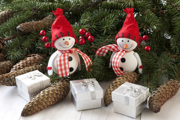 Happy snowmans with christmas decoration