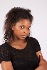 Black woman with a thoughtful look