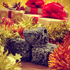 candy coal and christmas ornaments and gifts, with a retro effec