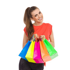 Girl with colorful shopping bags