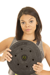 Hawaiian woman fitness hold big weight in front