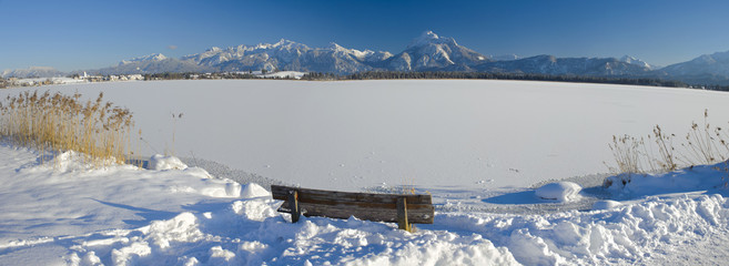 panorama landscape in Bavaria with lake Hopfensee and alps