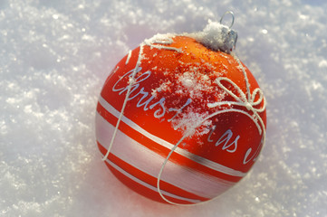 red xmas ball in snow