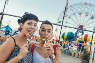 Happy Young Women eating Lollipop