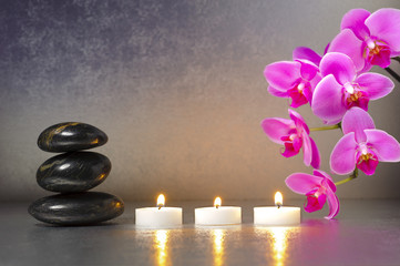 Japanese ZEN garden with stones, candle lights and orchid flower