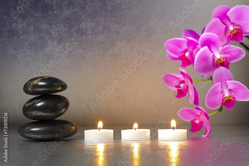Juliste Japanese ZEN garden with stones, candle lights and orchid flower