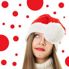 Cute teenage girl with Christmas hat looking up