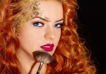 Beautiful woman makeup brush