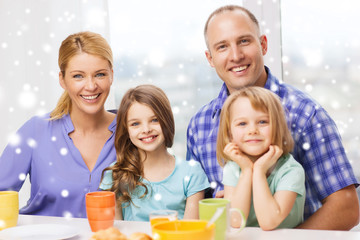 happy family with two kids having breakfast