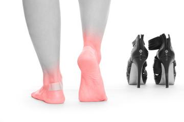 Füße schmerzen durch tragen von Absatzschuhen- isoliert