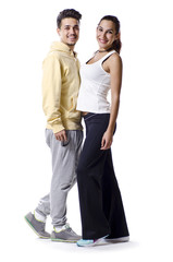 Casual couple on white background smiling