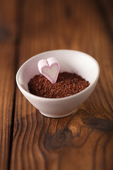 fine grated chocolate and heart marshmallow candy in  bowl  , wo