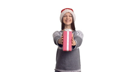 young charming girl presenting a gift in a Santa Claus
