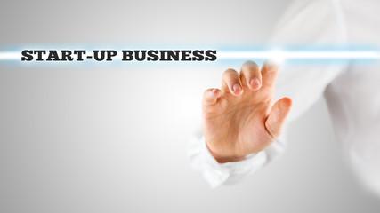 Finger Highlighting Startup Business Words