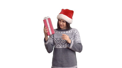 young charming girl receives a gift in a Santa Claus
