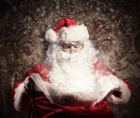 Santa Claus holding bag of gifts