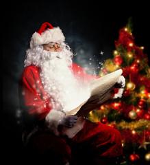 Santa Claus holding wish list