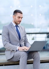 businessman working with laptop outdoors