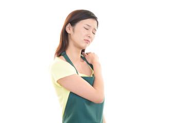 肩痛を訴える女性