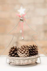 christmas decorative basket with pine cones