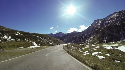 Vehicle driving on mountain pass road, POV