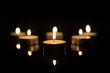 Leinwandbild Motiv Tea Candles with Reflection on Black